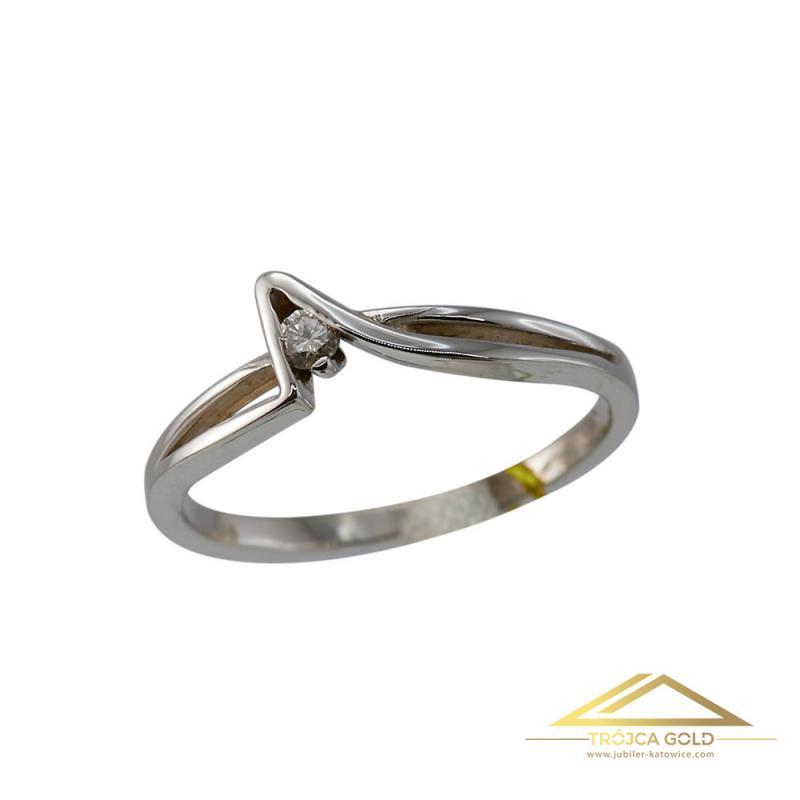 Złoty pierścionek z brylantem o masie 0,05 ct i wadze 1,46g