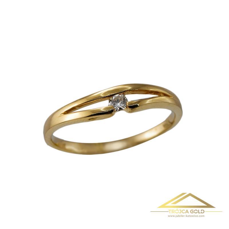 Złoty pierścionek z brylantem o masie 0,05 ct oraz wadze 1,57g