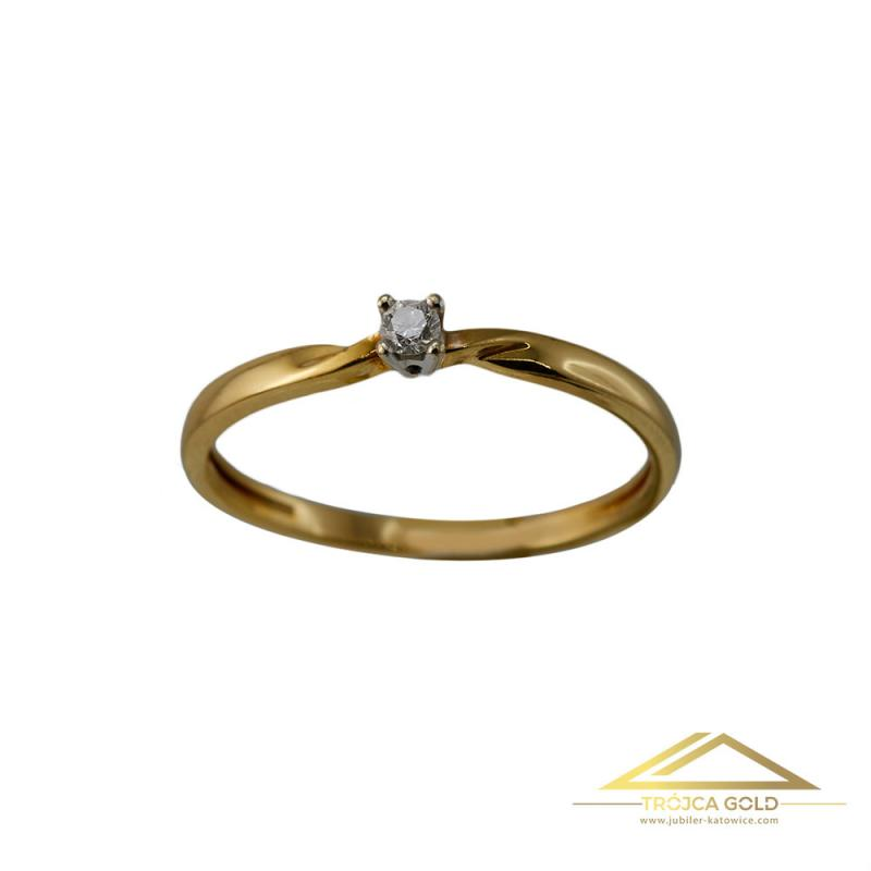 ?Złoty pierścionek z brylantem o masie 0,04 ct oraz wadze 1,66g