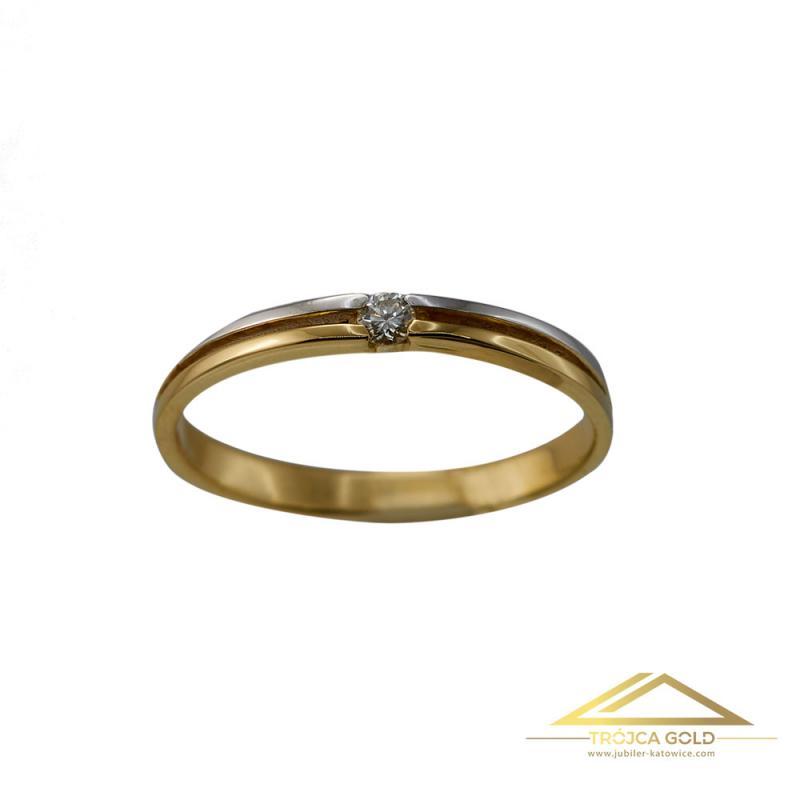 Złoty pierścionek z brylantem o masie 0,04 ct oraz wadze 1,65g