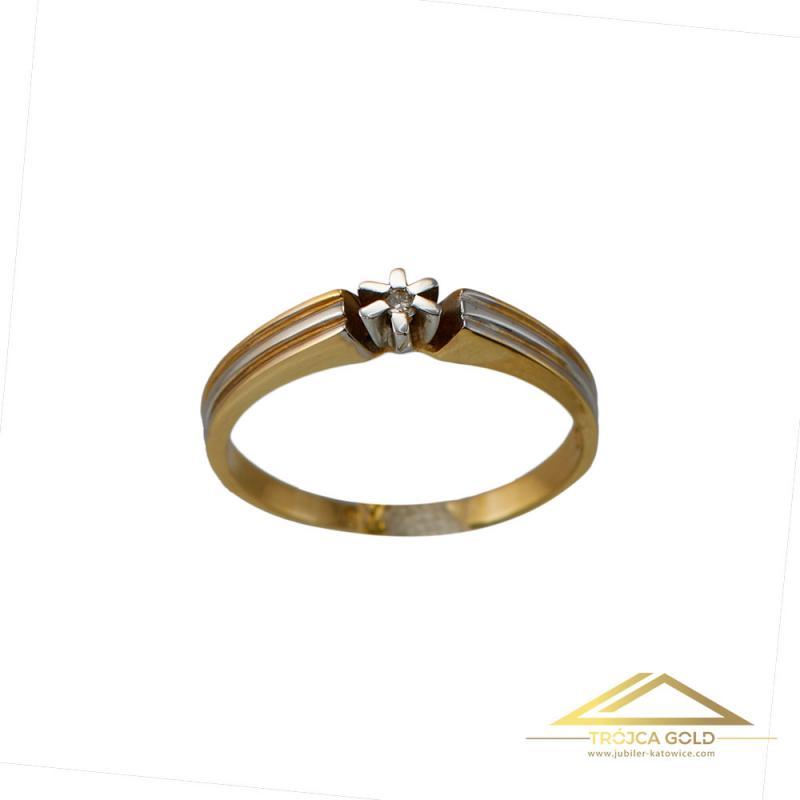 ?Złoty pierścionek z brylantem o masie 0,02 ct oraz wadze 1,53g