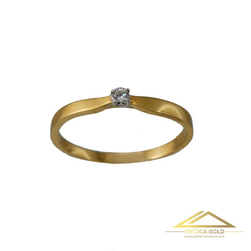 Złoty pierścionek z brylantem o masie 0,05 ct oraz wadze 1,16g