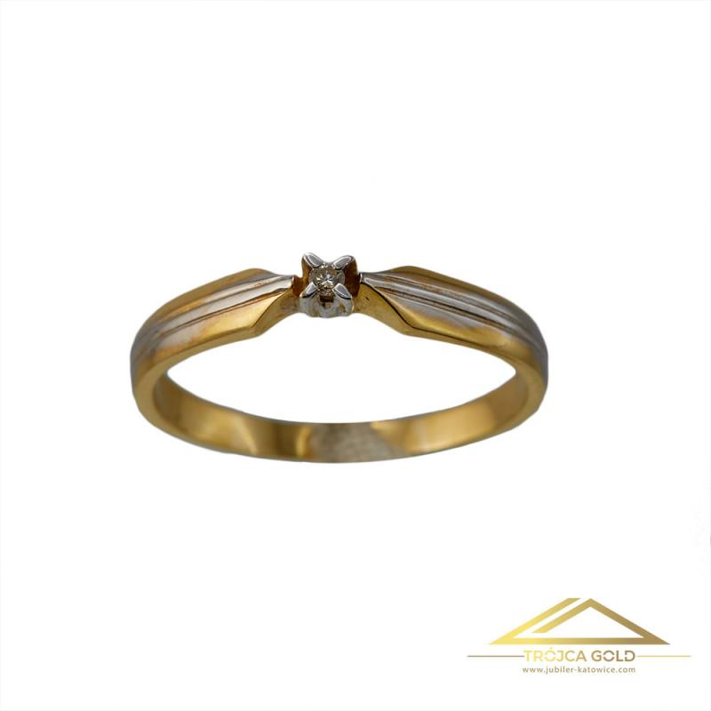 Złoty pierścionek z brylantem o masie 0,02 ct oraz wadze 1,61g